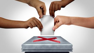 Illustration of diverse hands prevented from casting a ballot at a voting polling station.