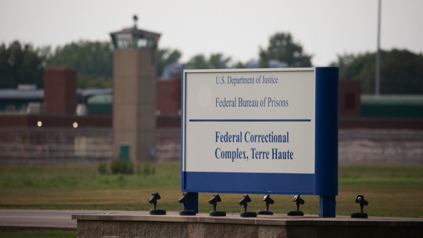 View of a sign outside the Terre Haute Federal Correctional Complex in Indiana.