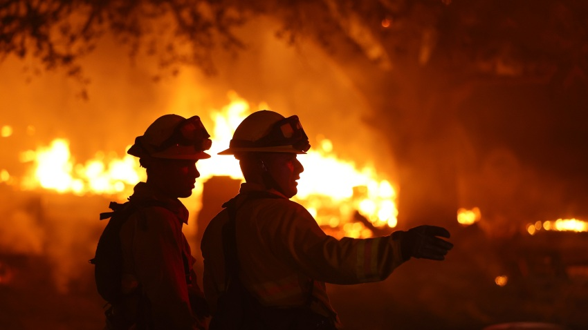 Firefighters battle the Glass Fire on October 01, 2020 in Calistoga, California. The fast moving Glass Incident Fire, originally called the Glass Fire, has burned 56,000 acres in Sonoma and Napa counties and has destroyed numerous wineries and structures. The fire is five percent contained.