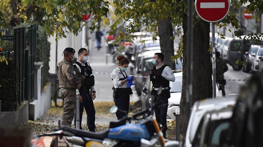 Security and emergency personnel on scene where an attacker armed with a sawn-off shotgun shot and wounded an Orthodox priest before fleeing on Oct. 31, 2020, in Lyon, France.