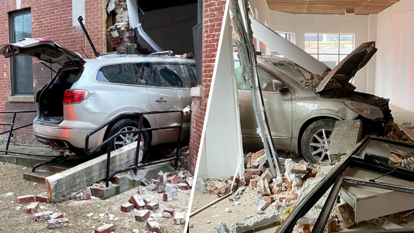 A silver vehicle crashed through the exterior of a downtown D.C. building, plowing through bricks and drywall before coming to rest halfway inside.