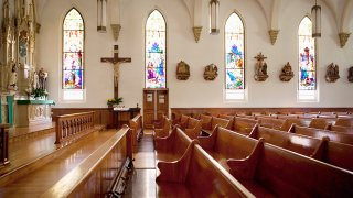 Pews and stained glass windows in church
