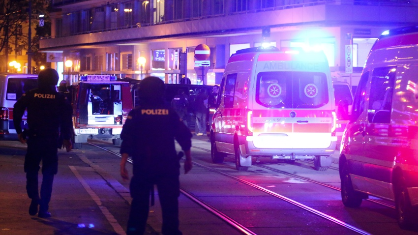 Austrian police say several people were injured and officers are out in force following gunfire in the capital Vienna, Nov. 2, 2020. Initial reports that a synagogue was the target of an attack couldn't immediately be confirmed. Austrian news agency APA quoted the country's Interior Ministry saying one attacker has been killed and another could be on the run.