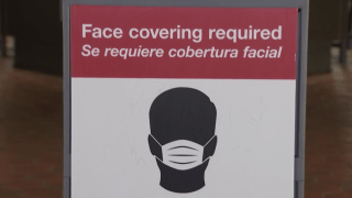 A sign at Metro tells riders that face coverings are required