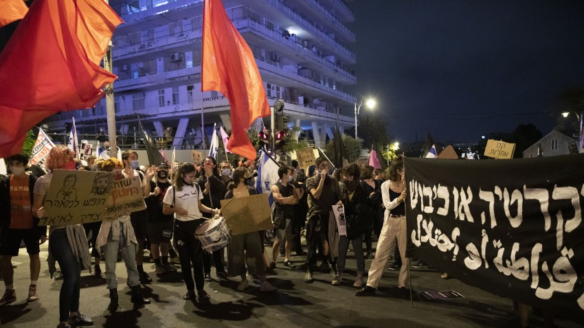 Israeli protestors gather on Saturday night in protest against Prime Minister Benjamin Netanyahu demanding his resignation over corruption cases and his failure to combat the new type of coronavirus (Covid-19) pandemic in West Jerusalem on October 31, 2020.