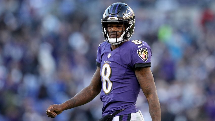 In this Jan. 6, 2019, file photo, Lamar Jackson #8 of the Baltimore Ravens reacts after a play against the Los Angeles Chargers during the fourth quarter in the AFC Wild Card Playoff game at M&T Bank Stadium in Baltimore, Maryland.