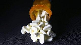 Opioid pills in a prescription bottle