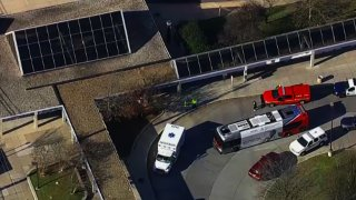 Emergency vehicles are shown outside the Glenmont Metro station.