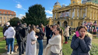 Residents gather outside in downtown Zagreb, Croatia, after an earthquake, Dec. 29, 2020.