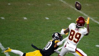 Cam Sims catches a pass against the Pittsburgh Steelers during the second half of their game at Heinz Field Dec. 7.