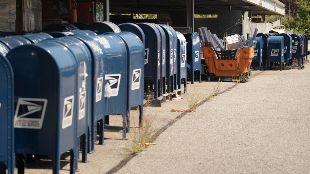 Dozens of mail boxes sit in the parking lot of a post office on Lafayette Avenue on Aug. 17, 2020, in the Bronx, New York.