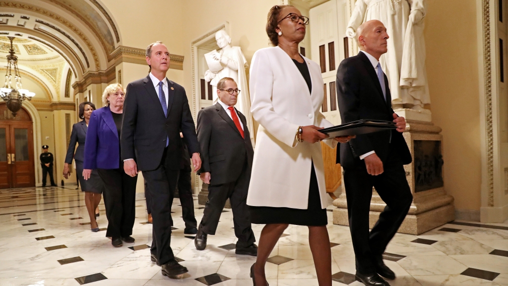 Lead by House of Representatives Clerk Cheryl Johnson and House Sergeant at Arms Paul Irving, impeachment managers Reps. Hakeem Jeffries (D-New York), Sylvia Garcia (D-Texas), Jerrold Nadler (D-New York), Adam Schiff (D-Calif), Val Demings (D-Fla.), Zoe Lofgren (D-Calif.) and Jason Crow (D-Colo.) march the articles of impeachment against President Donald Trump across the Capitol, Jan. 15, 2020 in Washington, D.C.