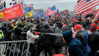 Trump supporters clash with police and security forces as they try to storm the US Capitol