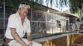 """In this Aug. 28, 2013, file photo, Joseph Maldonado answers a question during an interview at the zoo he runs in Wynnewood, Okla. Federal prosecutors on Friday, Sept. 7, 2018, announced that the zookeeper, also known as """"Joe Exotic,"""" and candidate for governor earlier this year, has been charged in a murder-for-hire scheme alleging he tried to hire someone to kill a Florida woman. Prosecutors allege Maldonado-Passage tried to hire two separate people to kill the woman, who wasn't harmed. Maldonado-Passage finished third in a three-way Libertarian primary in June."""