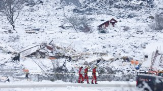 Rescue crews work in the area at Ask in Gjerdrum, Saturday Jan. 2, 2021, after a massive landslide smashed into a residential area near the Norwegian capital.