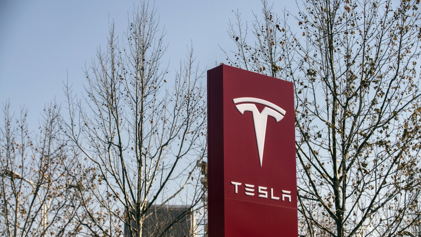 Signage at a Tesla Inc. showroom in Shanghai, China, on Friday, Jan. 8, 2021. Tesla customers in China wanting to get the new locally made Model Y are facing a longer wait, signaling strong initial demand for the Shanghai-built SUV.