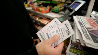 File photo of a person holding Powerball tickets.