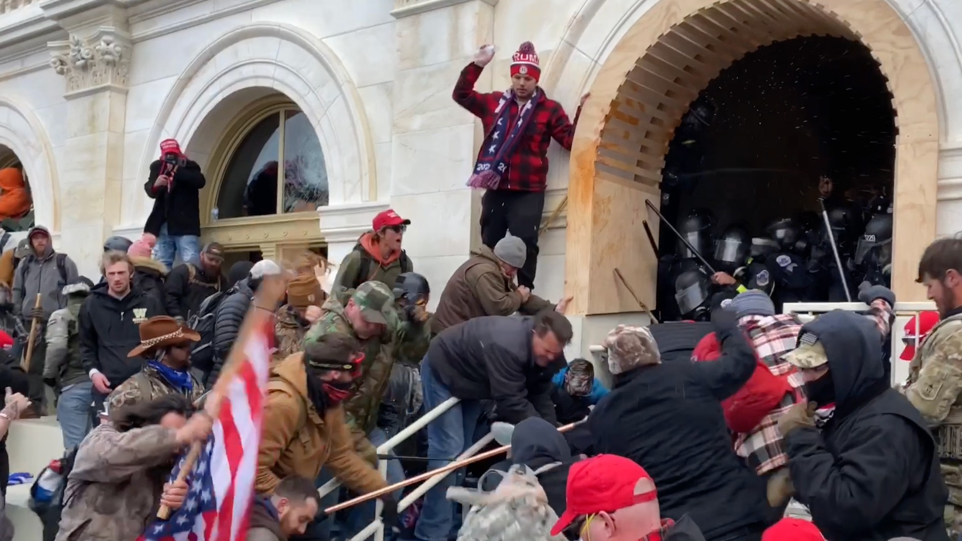 Capitol Rioter Beat DC Officer With Pole Flying American Flag