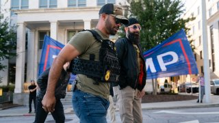 """Enrique Tarrio, leader of the Proud Boys, a far-right group, is seen at a """"Stop the Steal"""" rally against the results of the U.S. Presidential election outside the Georgia State Capitol on November 18, 2020 in Atlanta, Georgia."""