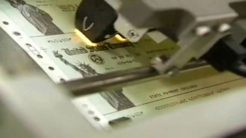 Checks from the US Department of Treasury being printed