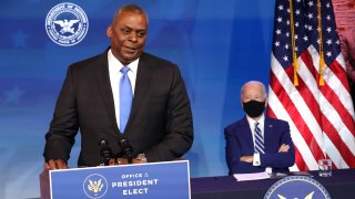 U.S. Army (retired) General Lloyd Austin (L) speaks after being formally nominated to be Secretary of the Department of Defense by U.S. President-elect Joe Biden (at the Queen Theatre on December 09, 2020 in Wilmington, Delaware. The only African-American to have headed U.S. Central Command, Lloyd Austin, 67, is a four-star general who was in charge of American forces in Iraq from 2010 to late 2011.