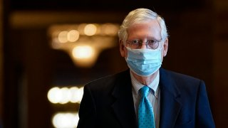In this Feb. 8, 2021, file photo, Senate Minority Leader Mitch McConnell (R-KY) leaves his office and walks to the Senate floor at the U.S. Capitol in Washington, D.C.