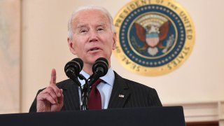 In this Feb. 22, 2021, file photo, President Joe Biden speaks about lives lost to Covid after death toll passed 500,000, in the Cross Hall of the White House in Washington, D.C.