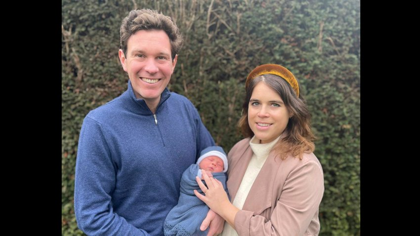 Britain's Princess Eugenie and her husband, Jack Brooksbank pose for a photo with their son