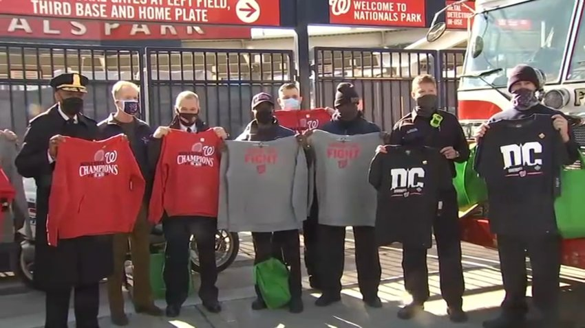 First responders accept swag from the Washington Nationals.