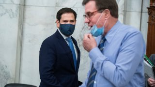 UNITED STATES - JUNE 24: Acting Chairman Sen. Marco Rubio, R-Fla., left, and vice chairman Sen. Mark Warner, D-Va., arrive for the Senate Select Intelligence Committee confirmation hearing for Peter Michael Thomson, nominee to be inspector general of the Central Intelligence Agency, in Russell Building on Wednesday, June 24, 2020.