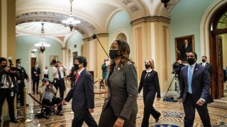 The impeachment managers Representatives Ted Lieu (D-CA), Stacey Plaskett (D-US Virgin Islands AT-Large), Joe Neguse (D-CO), and Madeleine Dean (D-PA) leave the Senate floor after delivering the article of impeachment on Capitol Hill on January 25, 2021 in Washington DC.