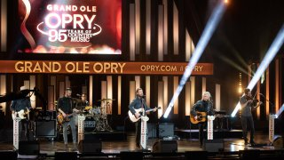 """In this image released on February 14th, Dierks Bentley and Marty Stuart perform during the """"Grand Ole Opry: 95 Years of Country Music"""" special at the Grand Ole Opry in Nashville, Tennessee."""