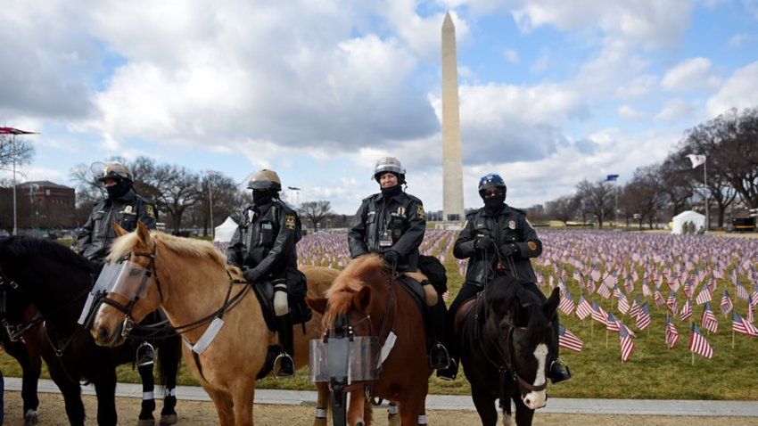 U.S. Park Police officers on horses patrol the National Mall close to the Washington Monument ahead of the inauguration Jan. 20, 2021.