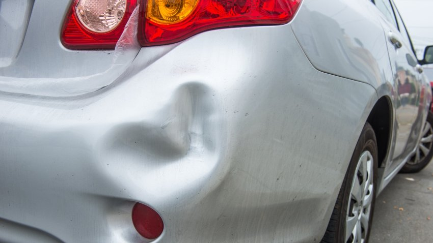 car dent dented car