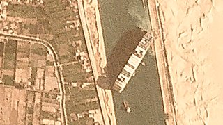 The cargo ship MV Ever Given sits wedged in the Suez Canal