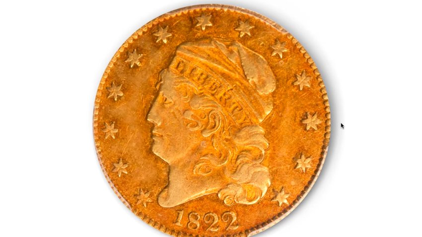 This image taken from video provided by Stack's Bowers Galleries shows a 1822 Half Eagle gold coin from the D. Brent Pogue Collection that was sold at Stack's Bowers Galleries in Las Vegas. The coin trading world has a new gold standard, after the only known 1822 half eagle $5 piece in private hands sold at auction in Las Vegas for $8.4 million, experts said Friday, March 26, 2021.