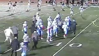 Football players from Wakefield and Marshall high schools fight