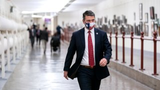 WASHINGTON, DC - JANUARY 12: Rep. Ronny Jackson (R-TX) wears a protective mask while walking through the Canon Tunnel to the U.S. Capitol on January 12, 2021 in Washington, DC. Today the House of Representatives plans to vote on Rep. Jamie Raskin's (D-MD) resolution calling on Vice President Mike Pence to invoke the 25th Amendment, removing President Trump from office. On Wednesday, House Democrats plan on voting on articles of impeachment.