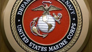 The US Department of the Navy, US Marine Corps, logo hangs on the wall February 24, 2009, at the Pentagon in Washington, DC.