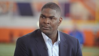 In this March 6, 2014, file photo, former NFL player Keyshawn Johnson looks on during the Clemson football Pro Day in Clemson, South Carolina. Johnson announced on Monday, March 15, 2021, that his daughter died at the age of 25.