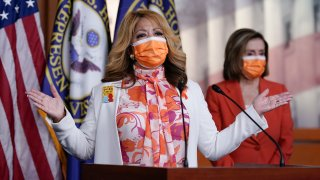 In this March 11, 2021, photo, Rep. Lucy McBath, D-Ga., whose son was a victim of gun violence, joins Speaker of the House Nancy Pelosi, D-Calif., at a news conference on passage of gun violence prevention legislation, at the Capitol in Washington. The House recently passed legislation that would require background checks for gun purchases, a signature Democratic issue for decades. But there wasn't so much as a statement issued by the White House. President Joe Biden's views on gun regulation have evolved along with his party.