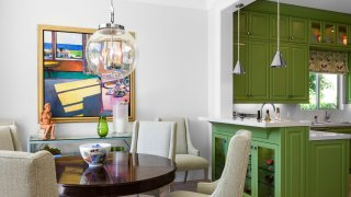 This image provided by Tom Stringer Design Partners shows a kitchen and dining room