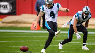 FILE - In this Sunday, Nov. 8, 2020 file photo, Carolina Panthers kicker Joey Slye (4) attempts an onside kick with the Kansas City Chiefs recovered during the second half of an NFL football game in Kansas City, Mo. NFL owners approved eliminating overtime in preseason games and expanded selection of jersey numbers for receivers, running backs and defensive backs. The owners did approve establishing a maximum number of players in the setup zone (between 10 and 25 yards from the kickoff) in hopes of enhancing onside kick opportunities. Defending teams will be limited to nine players in that zone, Wednesday, April 21, 2021.