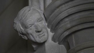 A limestone head of Holocaust survivor and Nobel Peace Prize winning author Elie Wiesel, carved by Sean Callahan from a clay sculpture by artist Chas Fagan, is almost complete in the Human Rights Porch of the Washington National Cathedral, Friday, April 16, 2021.