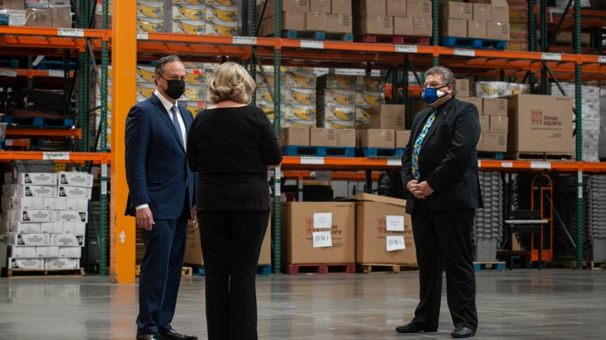 Doug Emhoff, husband of Vice President Kamala Harris, talks with Jodi Tyson, Vice President of Strategic Operations, and and Robert Thompson Deputy Administrator of the Supplemental Nutrition Assistance Program in Nevada, during a tour of Three Square Food Bank in Las Vegas, Nevada, March 15, 2021.
