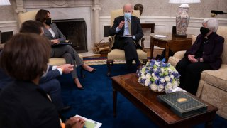 US President Joe Biden speaks as US Vice President Kamala Harris (center L), Janet Yellen (R), Secretary of the Treasury; Cecilia Rouse (L), Chair of the Council of Economic Advisers; and Brian Deese (2L), Director of the National Economic Council look on during the weekly economic briefing in the Oval office of the White House in Washington, DC, on April 9, 2021.