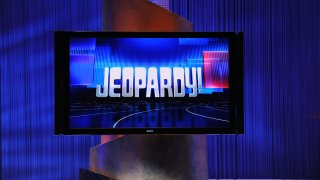 """This file photo shows a screen display the """"Jeopardy!"""" logo on set in Culver City, California."""