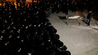 Mourners gather around the body of Menachem Knoblowitz, 21, from the United States, who died during Lag BaOmer celebrations at Mt. Meron in northern Israel