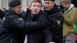 In this Sunday, March 26, 2017, file photo, Belarus police detain journalist Raman Pratasevich, center, in Minsk, Belarus. Raman Pratasevich, a founder of a messaging app channel that has been a key information conduit for opponents of Belarus' authoritarian president, has been arrested after an airliner in which he was riding was diverted to Belarus because of a bomb threat. The presidential press service said President Alexander Lukashenko personally ordered that a MiG-29 fighter jet accompany the Ryanair plane — traveling from Athens, Greece, to Vilnius, Lithuania — to the Minsk airport.