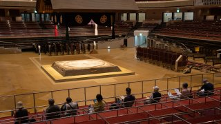 Local residents sit near the dohyo (sumo ring) as they wait under observation after receiving a coronavirus vaccine at Ryogoku Kokugikan sumo arena on May 24, 2021 in Tokyo, Japan. With one of the lowest Covid-19 vaccination rates in the developed world and with the Tokyo Olympic Games little over two months away, Japanese authorities have ramped up their inoculation efforts with mass vaccination sites opening today in Tokyo and Osaka as well as more community vaccination centres around the country.